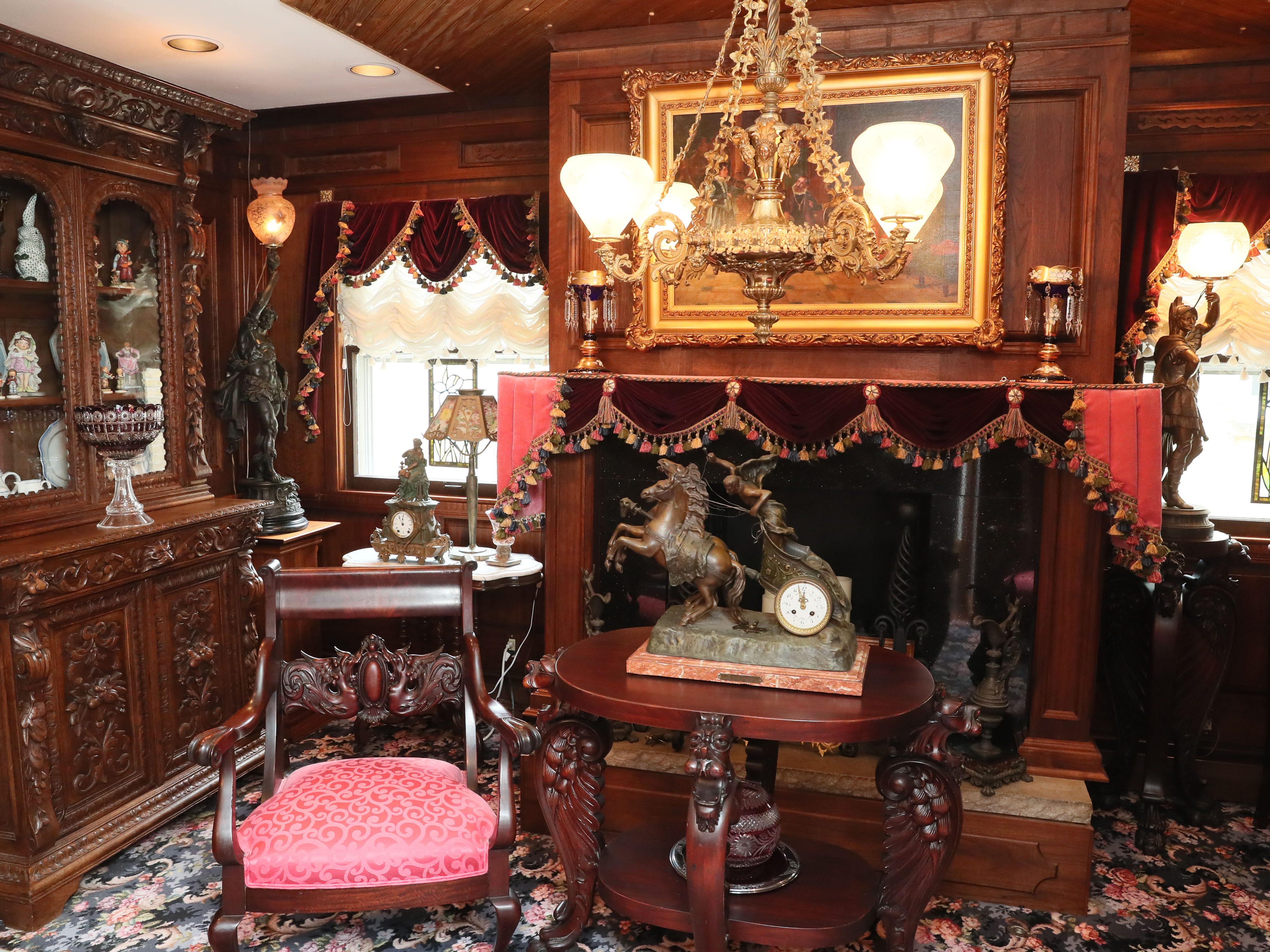 This room in the antiques-filled home has a gas fireplace and a custom-made rug in a vintage print.