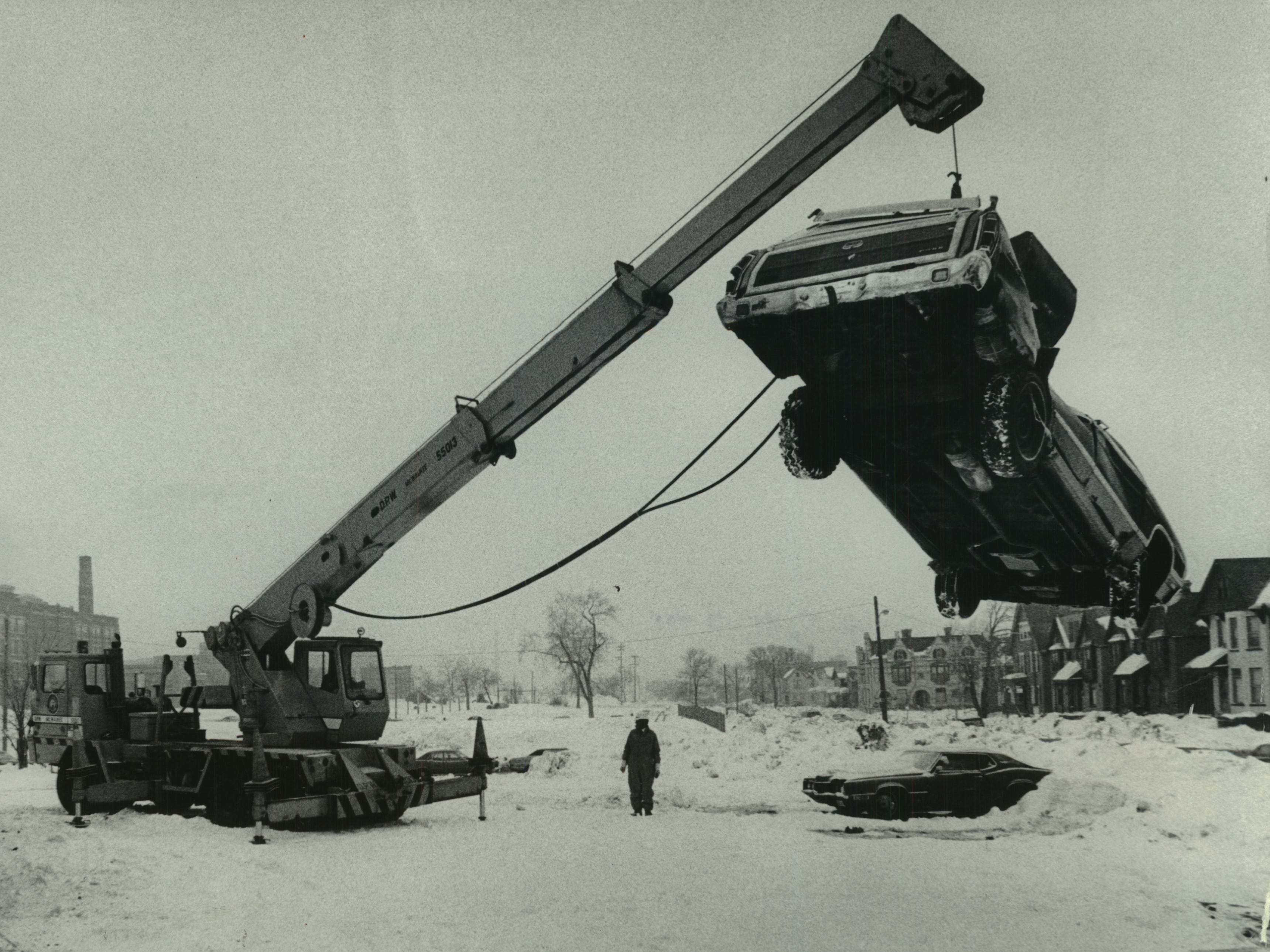 About 50 vehicles valued at less than $100 each were removed from a parking lot near North Astor and East Lyon streets and taken to a metal shredder on Feb. 15, 1979. The cars, all unclaimed, were found abandoned by the city during snow removal after the Jan. 23-24, 1979, snowstorm. More valuable cars that were not claimed were sold to salvage dealers. This photo was published in the Feb. 16, 1979, Milwaukee Journal.