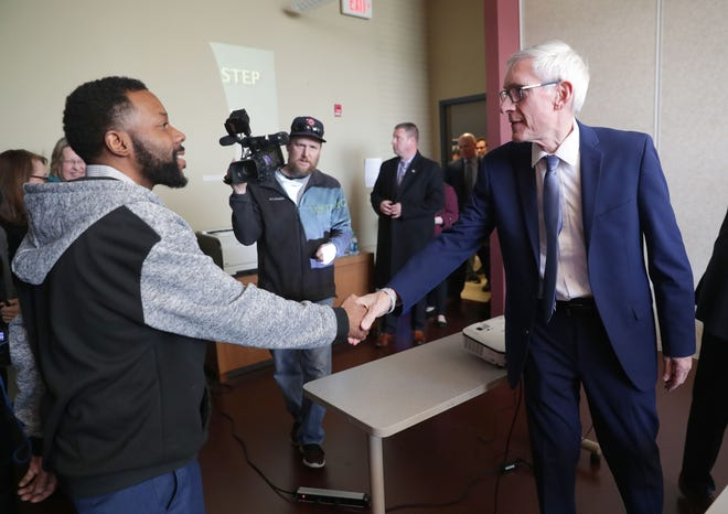 Gov. Tony Evers talks with Demetrius Johnson, a WRTP/Big Step program assistant, during a tour at the WRTP/Big Step (Wisconsin Regional Training Partnership Building Industry Group and Skilled Trades Employment Program) at 3841 W. Wisconsin Ave. in Milwaukee on Monday, Jan. 14, 2019. The stop was aimed at highlighting workforce development and entrepreneurship in Milwaukee.