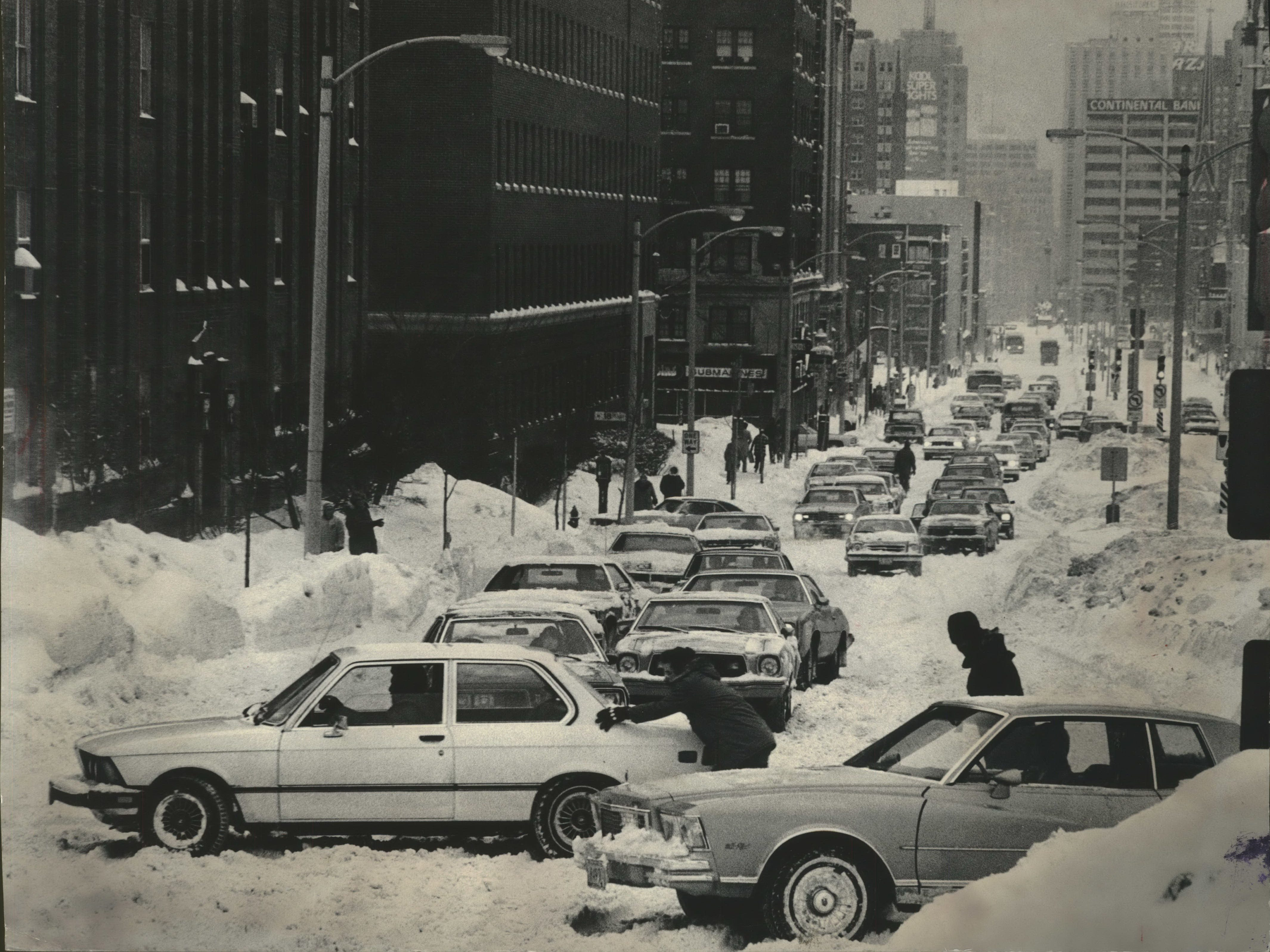 A car stuck at 19th Street adds to the troubles of motorists moving west on Wisconsin Avenue during rush hour on Jan. 24, 1979. At the time, Milwaukee drivers were grappling with their third major snowstorm in less than a month. This photo was published in the Jan. 25, 1979, Milwaukee Sentinel.