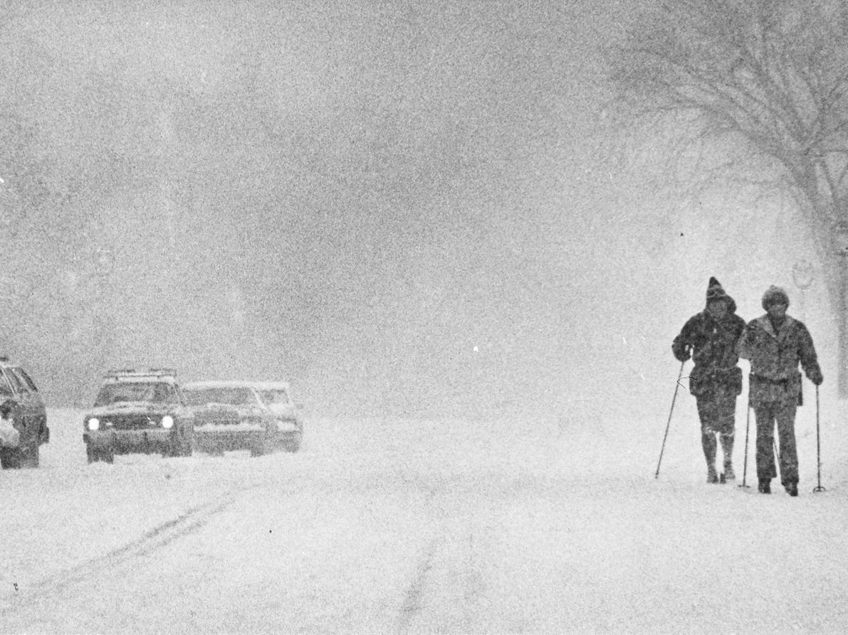 Roy Mercer and Bob Diggelman ski to work alongside traffic on North Lincoln Memorial Drive on Jan. 24, 1979. With crews trying to keep up with the city's third major snowstorm in less than a month, it seemed a safer transportation bet. This photo was published in the Jan. 25, 1979, Milwaukee Sentinel.