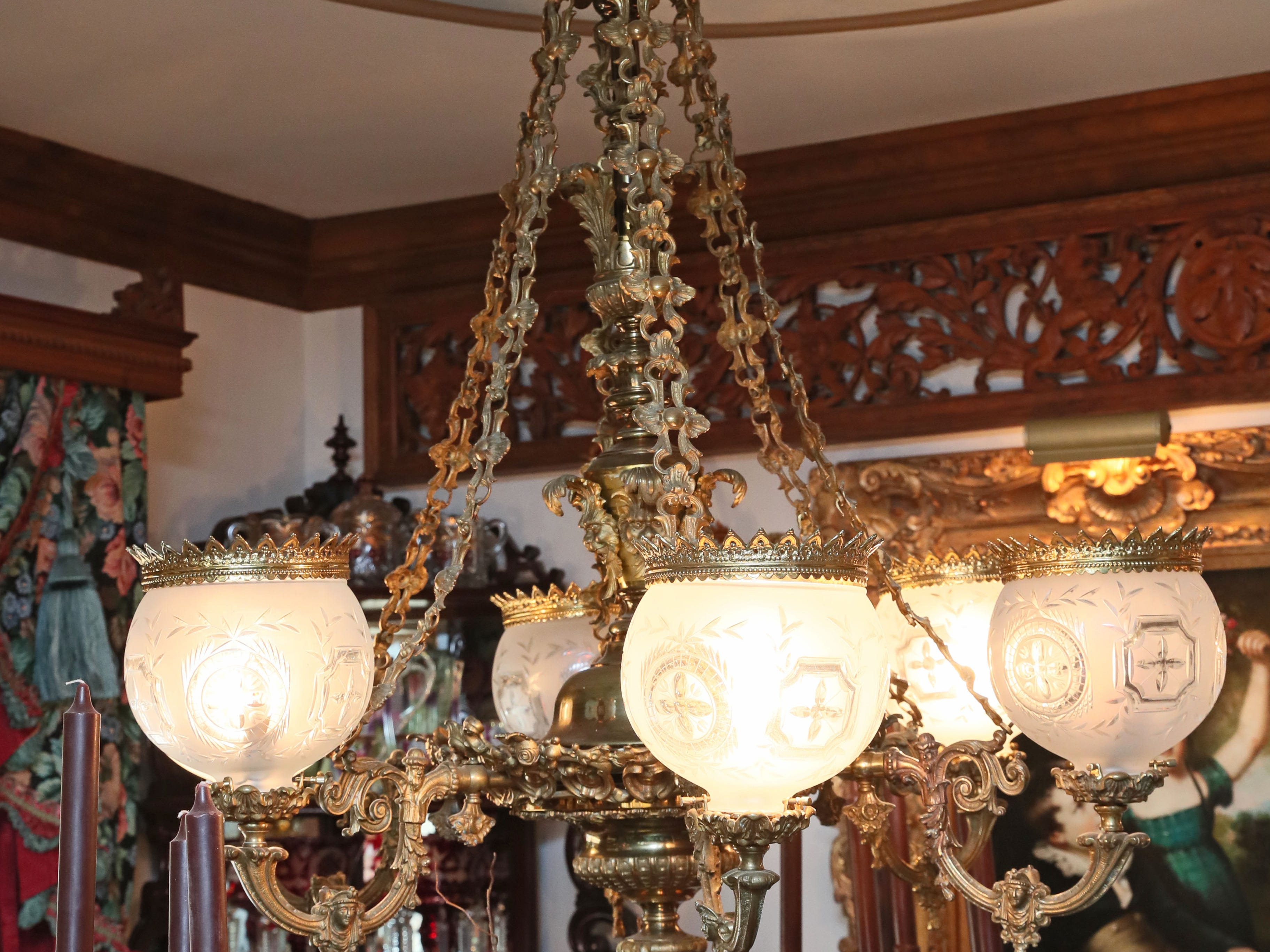 A Cornelius & Baker chandelier from the Josiah Noonan House in Milwaukee hangs above the dining room table.