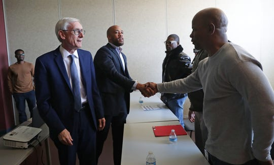 Lt. Gov. Mandela Barnes shakes hands with WRTP/Big Step participant Thadius Jones with Gov. Tony Evers (far left), during a tour at the WRTP/Big Step at 3841 W. Wisconsin Ave. in Milwaukee on Monday.