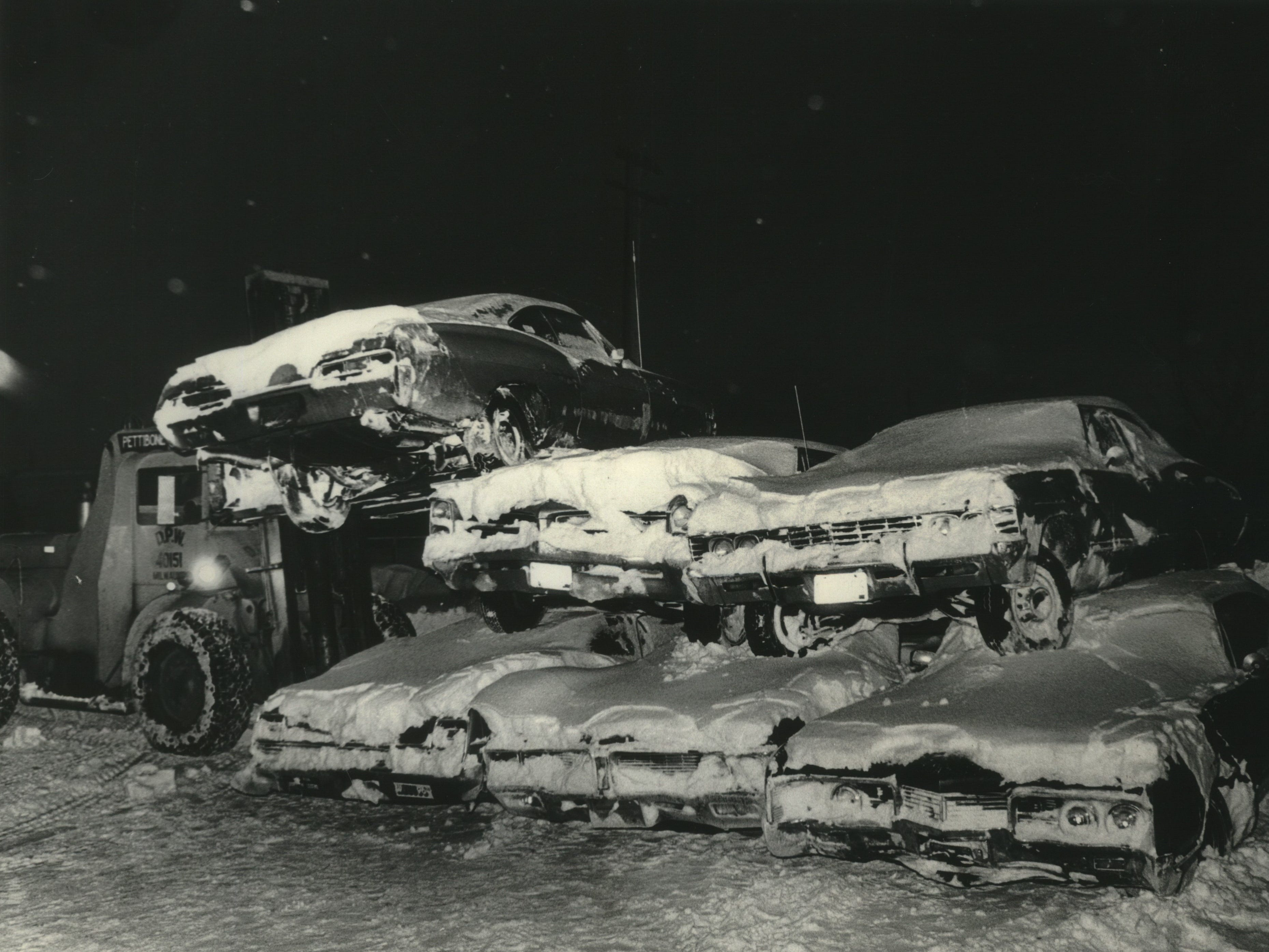 Cars keep on piling up on Jan. 19, 1979, in Milwaukee's Northwest Side storage lot, one of several sites in the city where vehicles abandoned during a blizzard were towed to try to clear Milwaukee's snow-clogged streets. Donald D. Roethig, assistant commissioner of public works, ordered the car-stacking. This photo was published in the Jan. 20, 1979, Milwaukee Journal.
