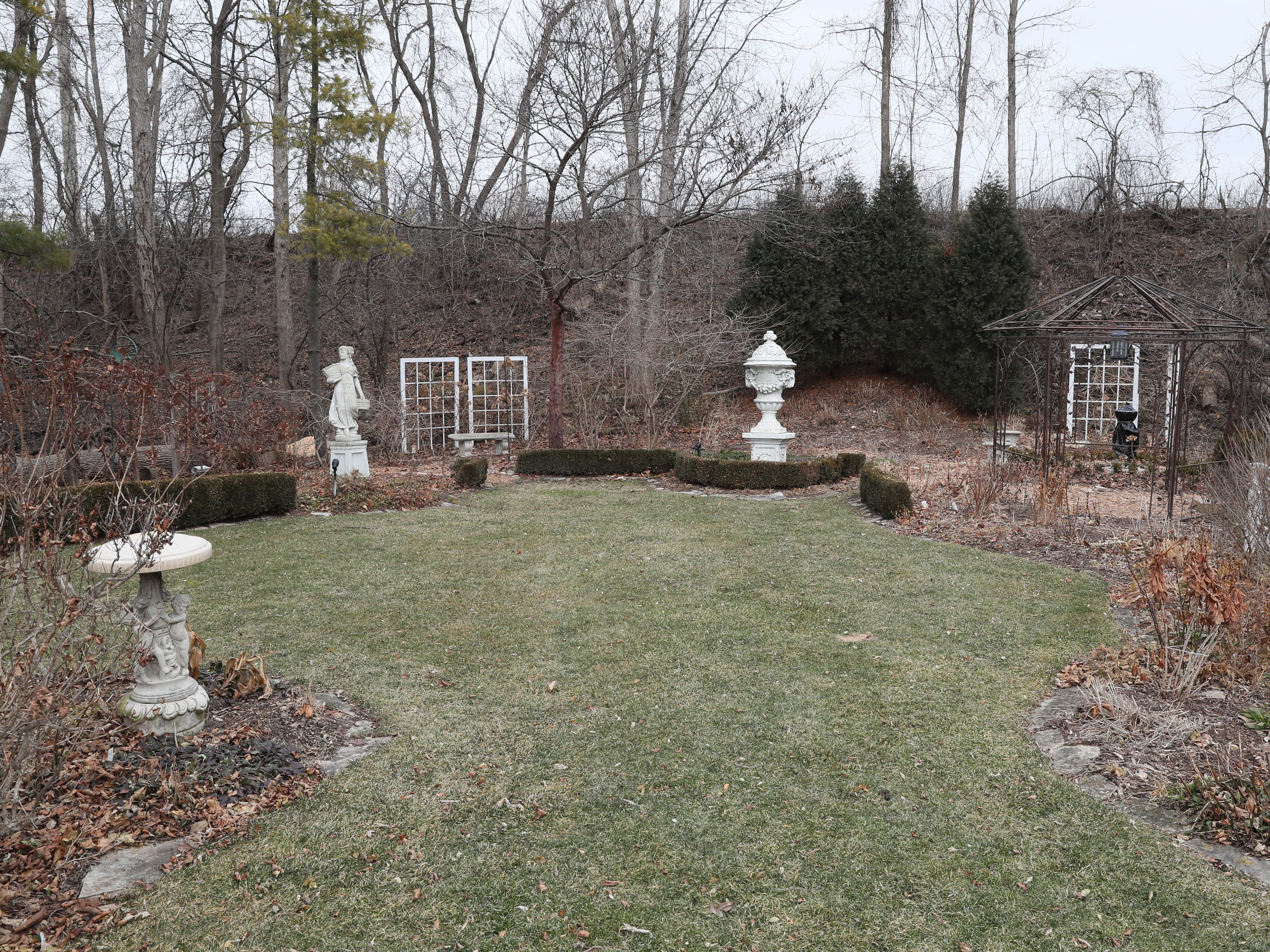 The garden statues and structures add interest to the backyard in winter.