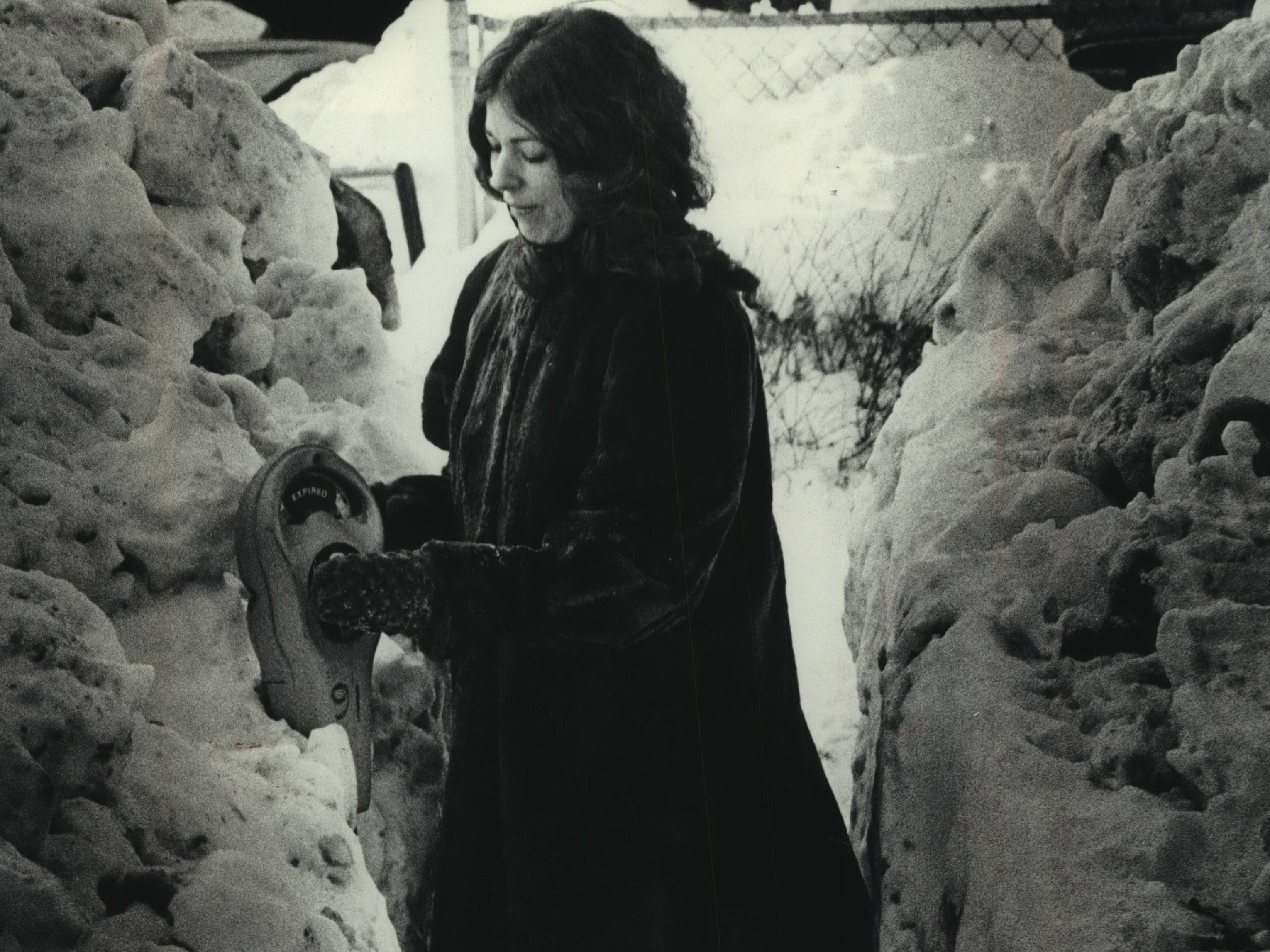 Peggy Kartheiser plus a meter on North Marshall Street on the east side of downtown Milwaukee, which was still digging out from more than three feet of snow in January 1979. This photo was published in the Feb. 3, 1979, Milwaukee Journal.