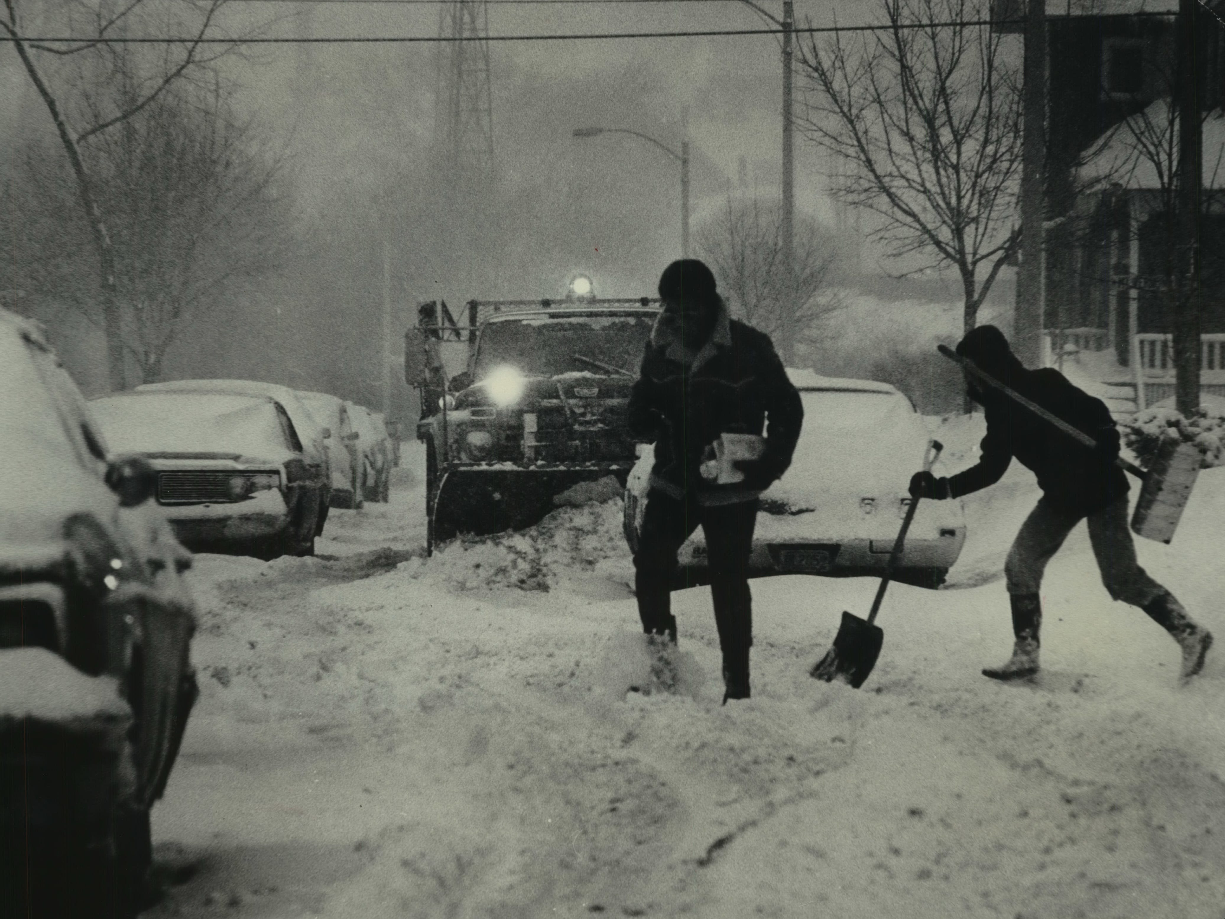 A pedestrian and a snow shoveler dash across North 37th Street as a plow works the Merrill Park neighborhood of Milwaukee on Jan. 24, 1979. The snowstorm was the third major winter blast to hit Milwaukee that month. This photo was published in the Jan. 24, 1979, Milwaukee Journal.
