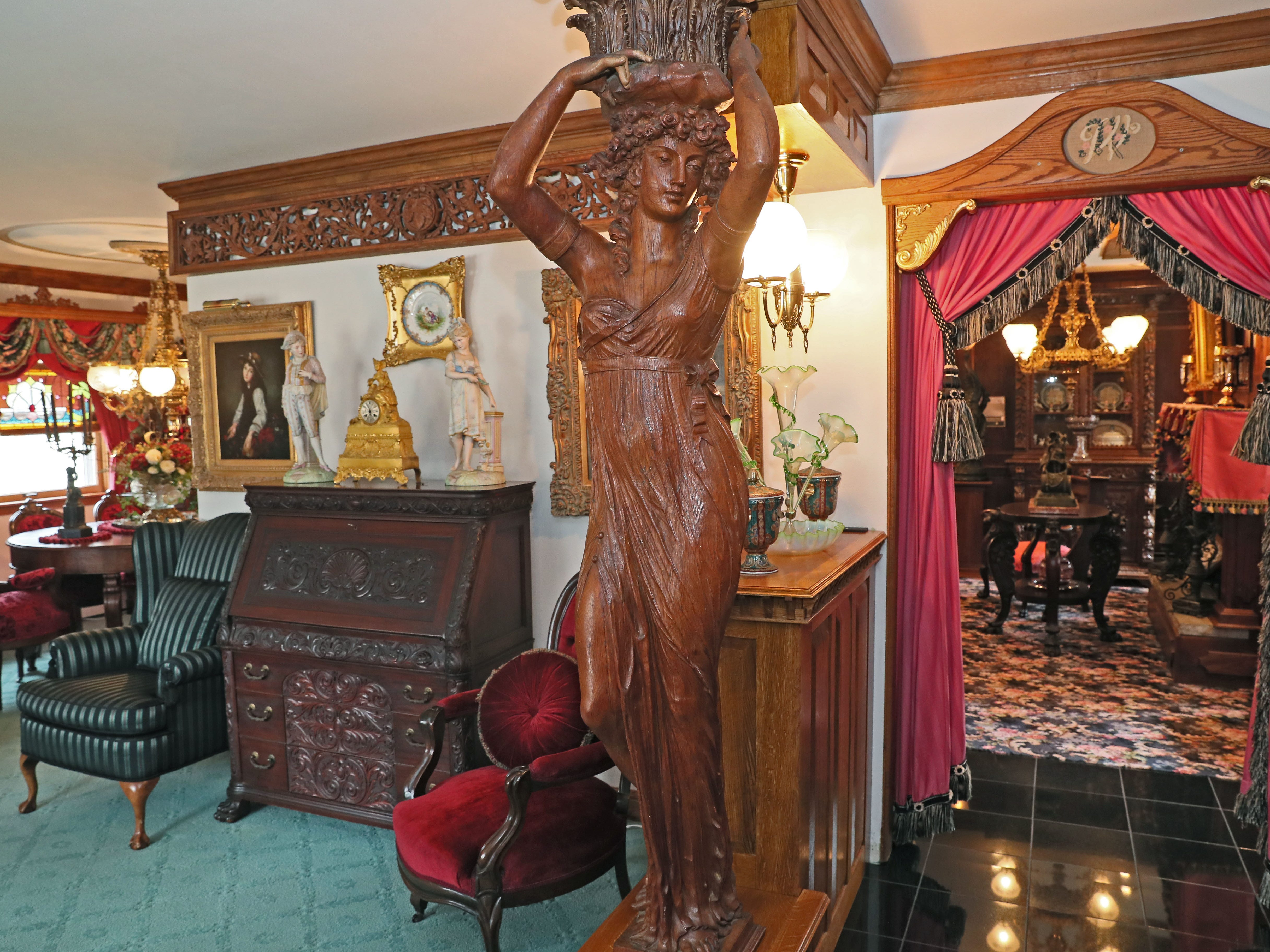 This carved newel post lady came from the Schandein Mansion in Milwaukee, located at 24th Street and Wisconsin Avenue.  At left is the living room, and  back left the dining room. The doorway at right leads to a sitting room with a fireplace.