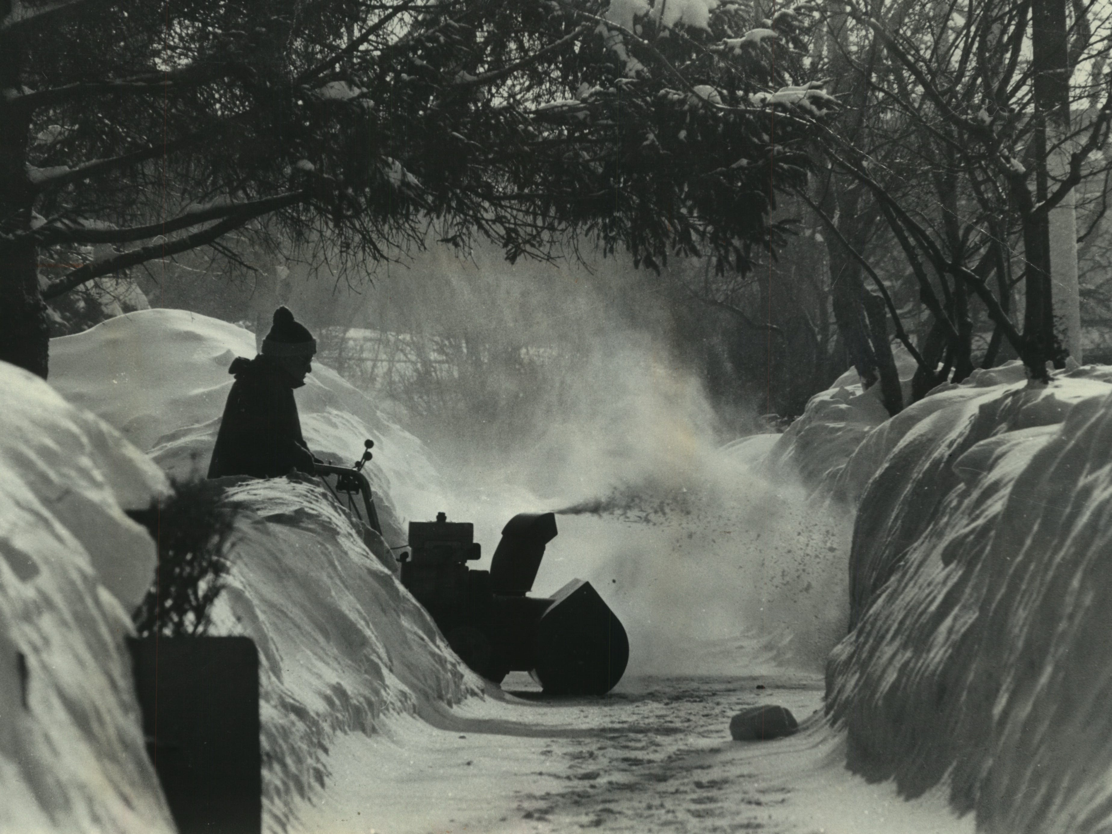 With snow already piled almost head high around him, Reuben J. Gothow uses a snowblower to clear new snow from the driveway of his home on Summit Avenue in Waukesha on Jan. 19, 1979. The new snow was on top of two 14-inch-plus snowstorms that had hit the Milwaukee area that month already. More was coming. This photo was published in the Jan. 19, 1979, Milwaukee Journal.
