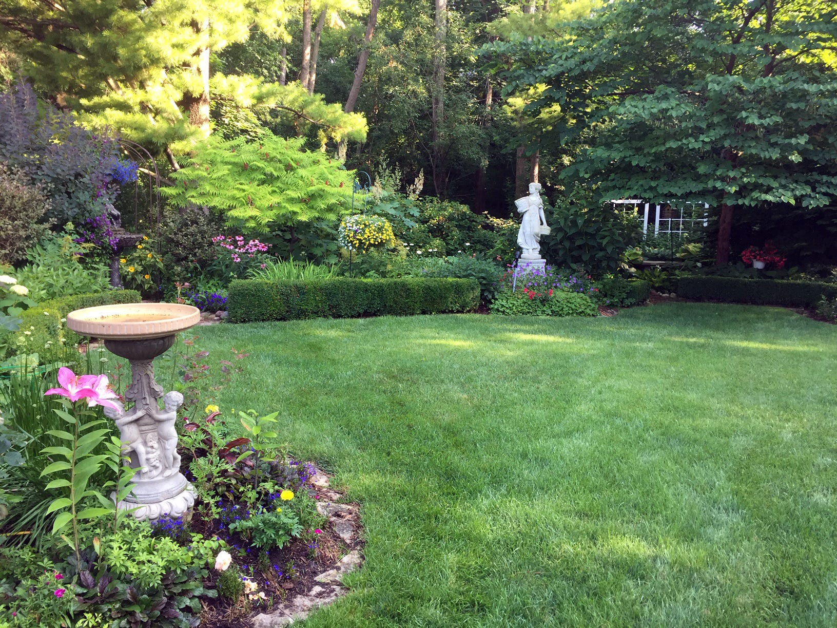 The Wissings did an English garden to go along with the interior of the home, as shown in this picture from summer.