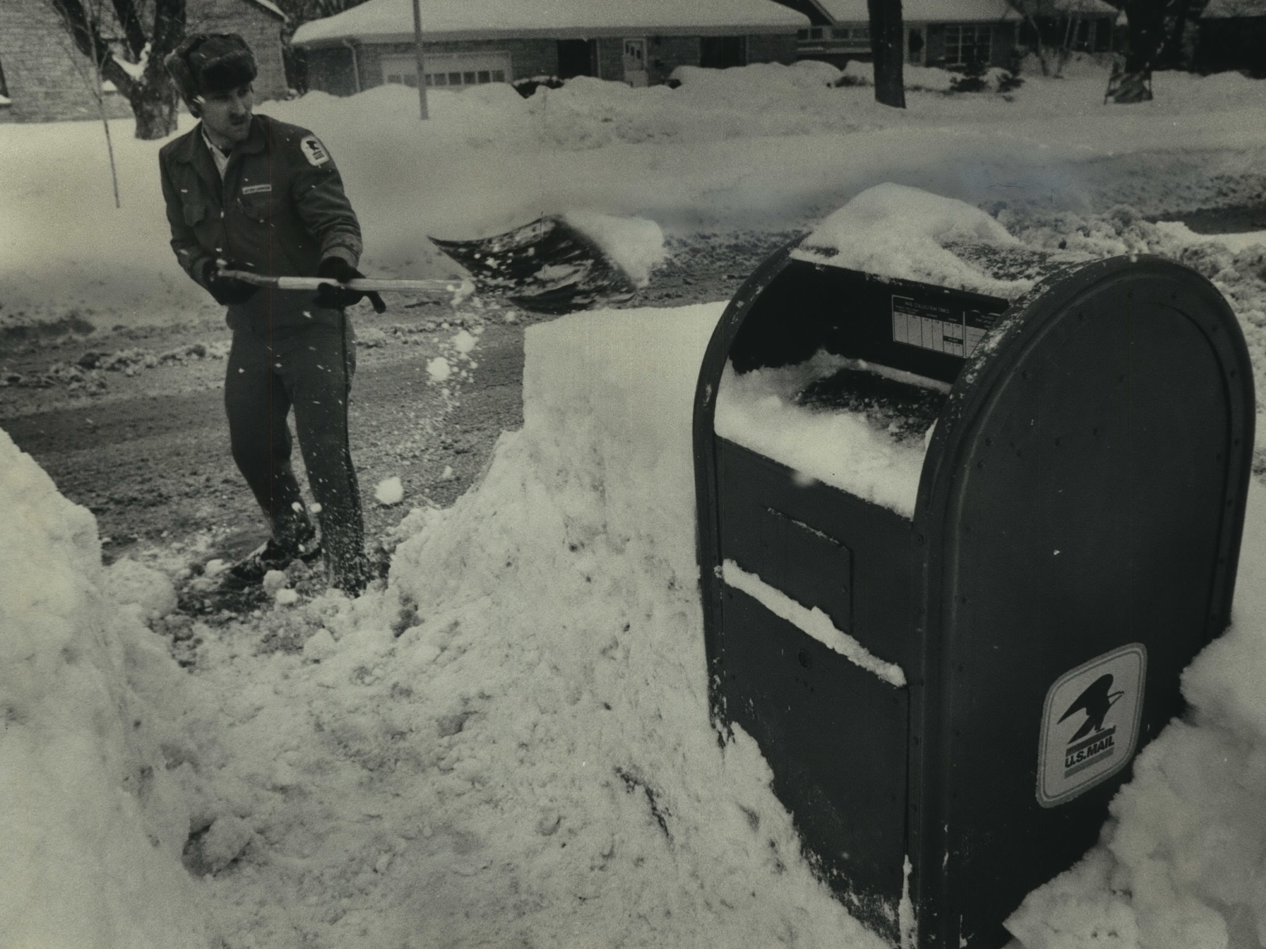During Milwaukee's blizzardy January of 1979, sometimes people took matters, and shovels, into their own hands. Letter carrier Mark Eisold clears a path to a mailbox on North Lake Drive near East Montclaire Avenue in Whitefish Bay on Jan. 19, 1979. This photo was published in the Jan. 20, 1979, Milwaukee Sentinel.
