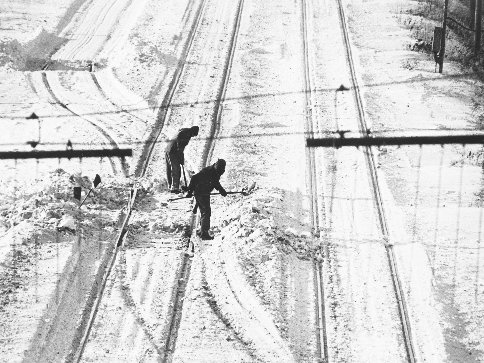 Railroad crews struggle to clear snow from rail switches around Milwaukee on Jan. 25, 1979. Switches frozen and buried under the three major snowstorms that hit MIlwaukee that month made it difficult for trains to get to the city - and to deliver materials needed by the city's major manufacturers, some of whom began laying off workers as a result. This photo was published in the Jan. 26, 1979, Milwaukee Journal.