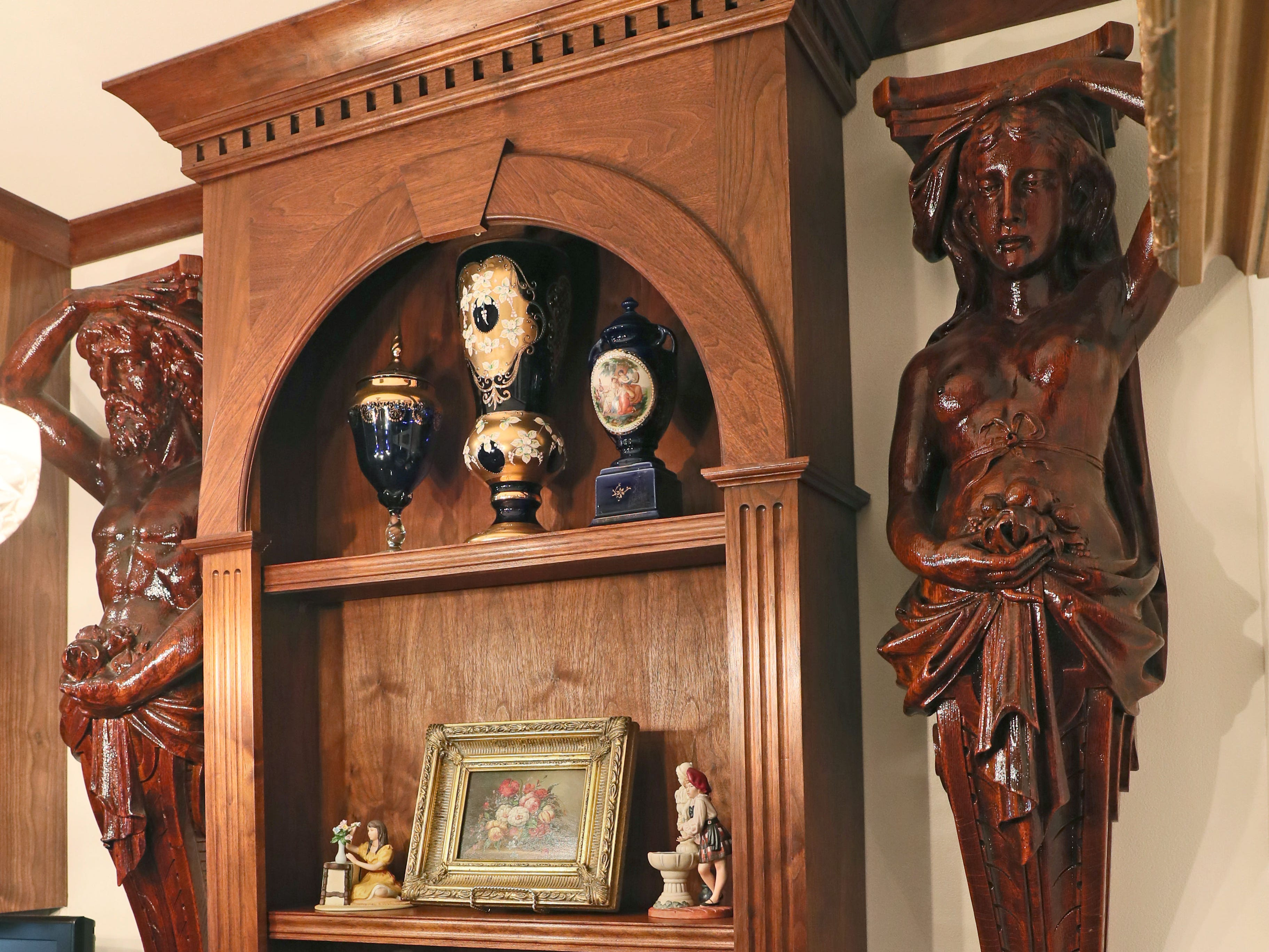 These hand-carved wood statues of a man and a woman, now in the Wissings'  kitchen, came from the Brumder mansion that was at 17th and Wisconsin.