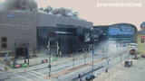 A view of the east side of the Bradley Center as the explosion went off. The massive steel roof of the Bradley Center was dislodged by explosives Sunday morning.