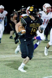 Salem's Jordan Turner carries during a game last season. Turner was recently named to the state's AP Super Team.