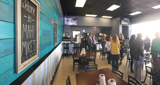 A crowd gathers for the grand opening ceremony at Mahi Mike's in Prattville.