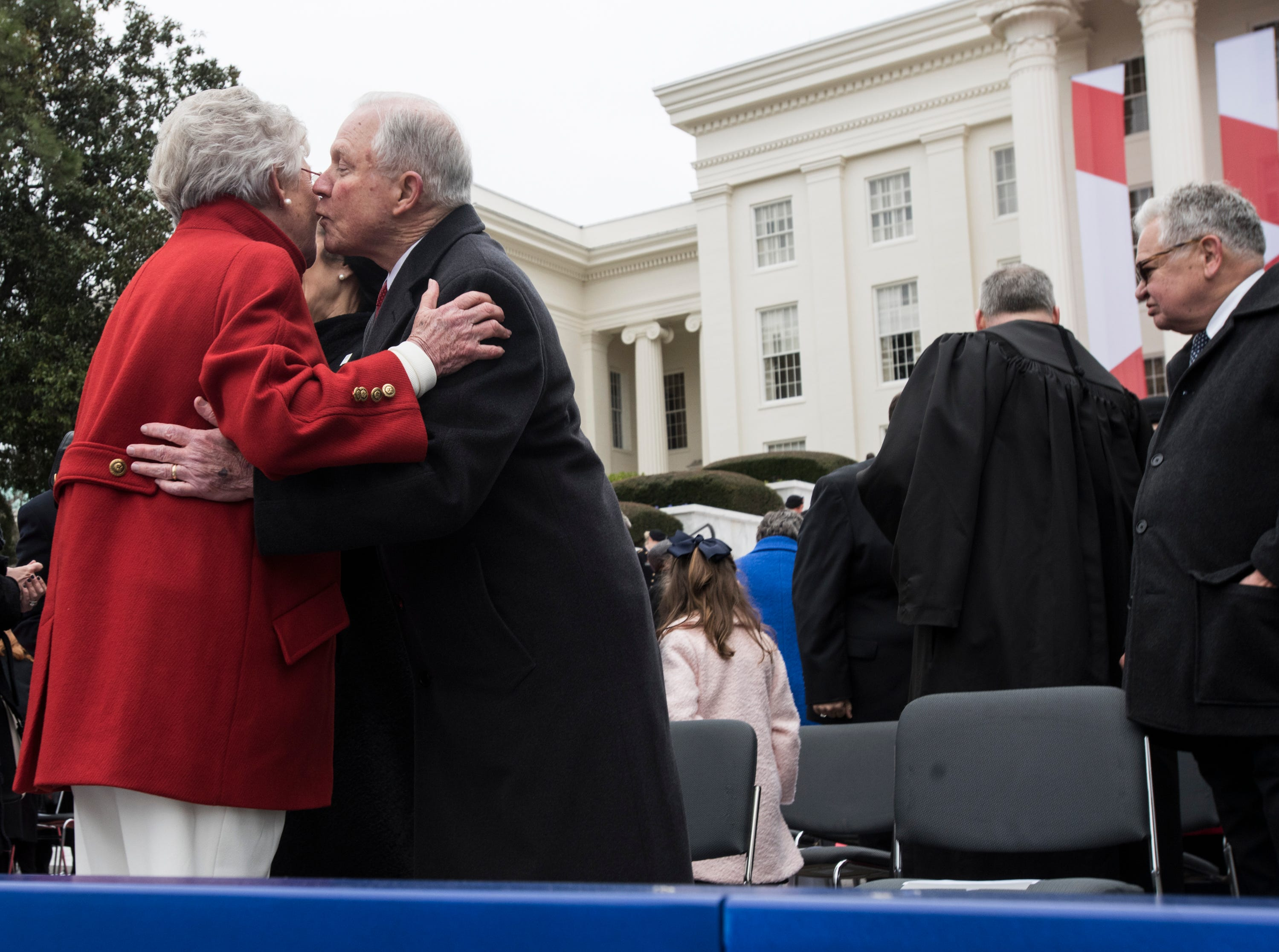 Former U.S. Attorney General Jeff Sessions congratulates Alabama Gov. Kay Ivey during Inauguration Day on the steps of the Alabama State Capitol in Montgomery, Ala., on Monday, Jan. 14, 2019.