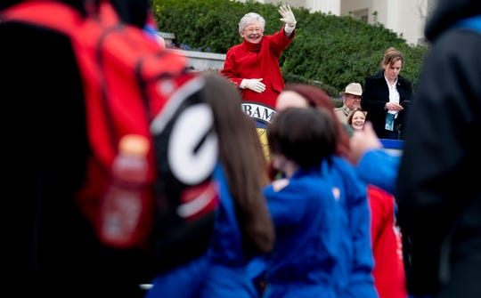 Governor Kay Ivey waves at those taking part in her Inauguration Parade in Montgomery, Ala., on Monday January 14, 2019.