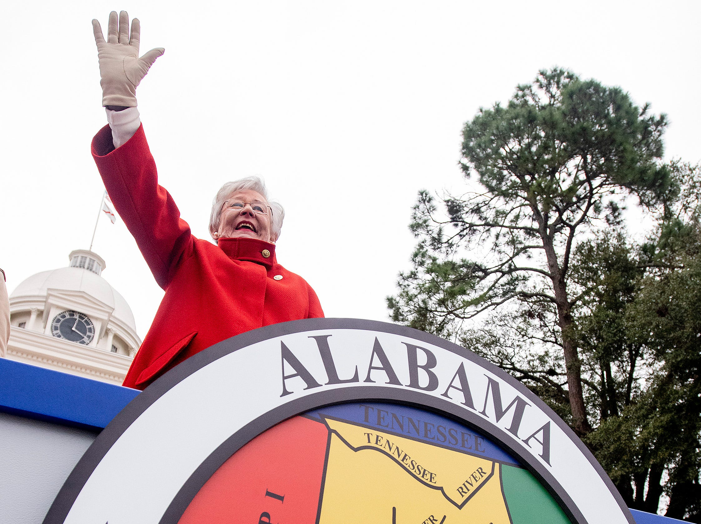 Alabama Governor Kay Ivey waves as she watches her Inaugural Parade in Montgomery, Ala., on Monday January 14, 2019.