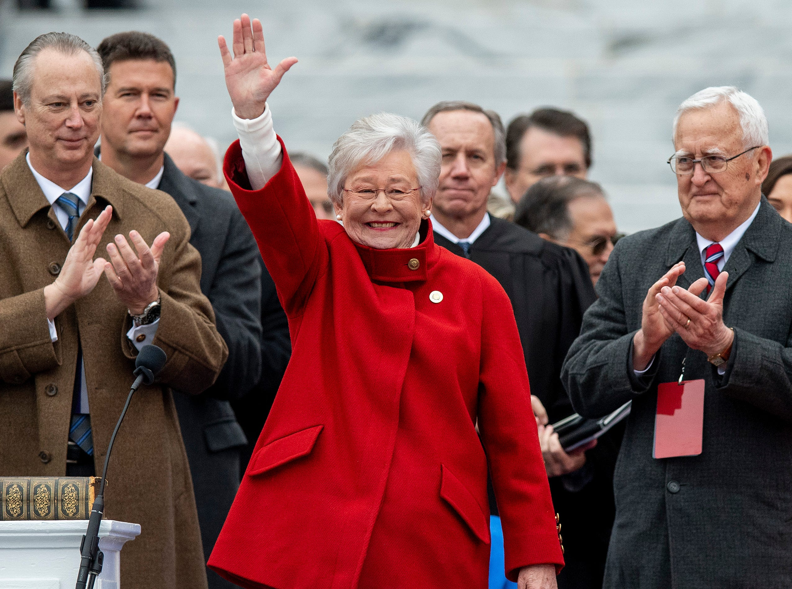 Governor Kay Ivey waves after being sworn in during her Inauguration on the state capitol steps in Montgomery, Ala., on Monday January 14, 2019.