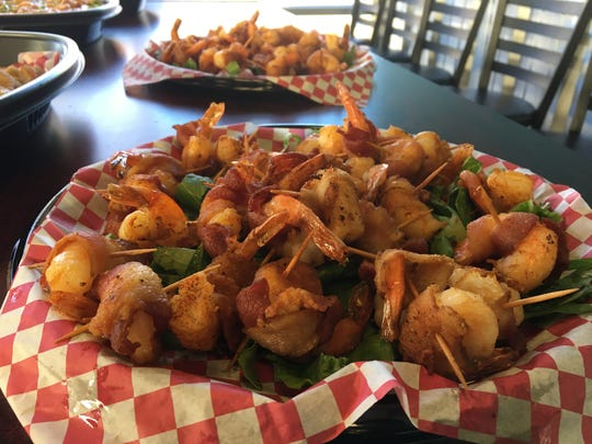 Bacon-wrapped shrimp is one of the specialties at the new Mahi Mike's in Prattville.