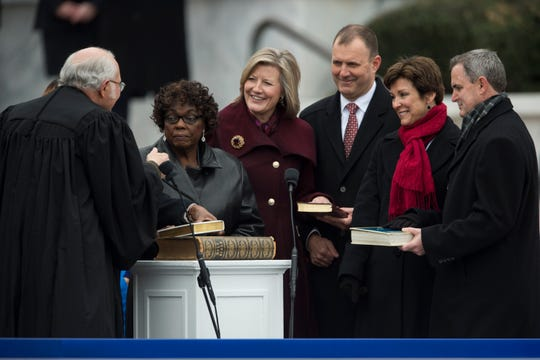 Members of the state board of education are sworn in during Inauguration  Day on the steps of the Alabama State Capitol in Montgomery, Ala., on Monday, Jan. 14, 2019.