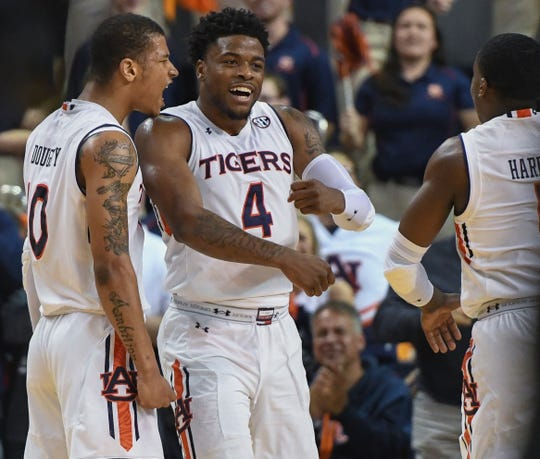 Auburn guard Samir Doughty (10) celebrates a dunk with Auburn's Malik Dunbar (4) against Georgia Saturday, Jan. 12, 2019, in Auburn, Ala.