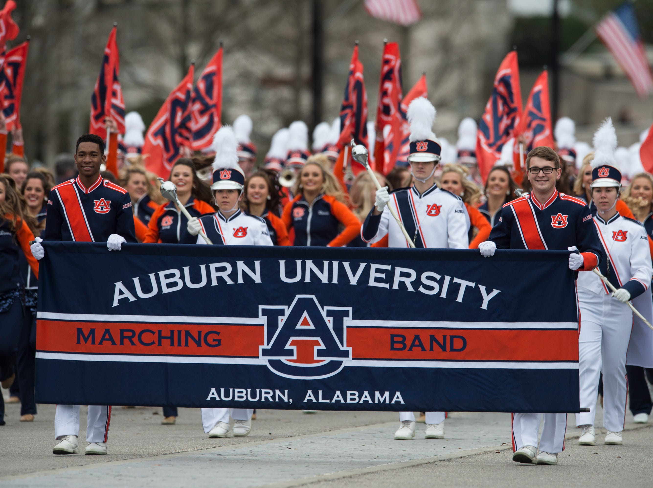 Auburn University marching band plays during the inauguration day parade in Montgomery, Ala., on Monday, Jan. 14, 2019.