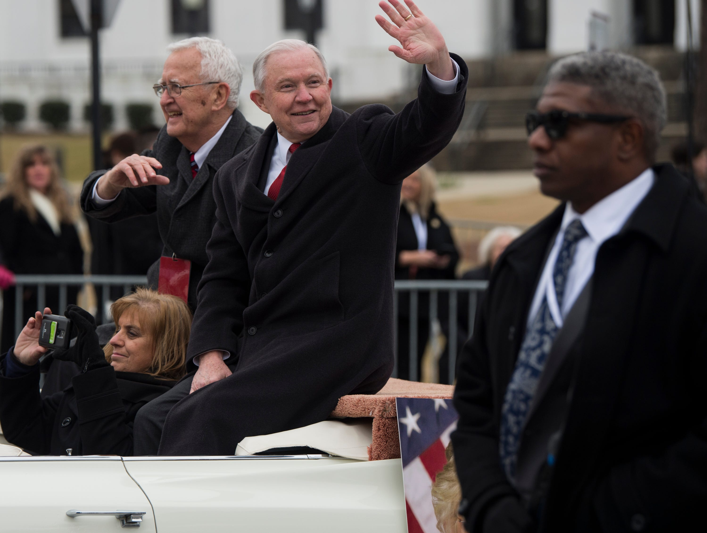 Former U.S. Attorney General Jeff Sessions waves to the crowd during the inauguration day parade in Montgomery, Ala., on Monday, Jan. 14, 2019.