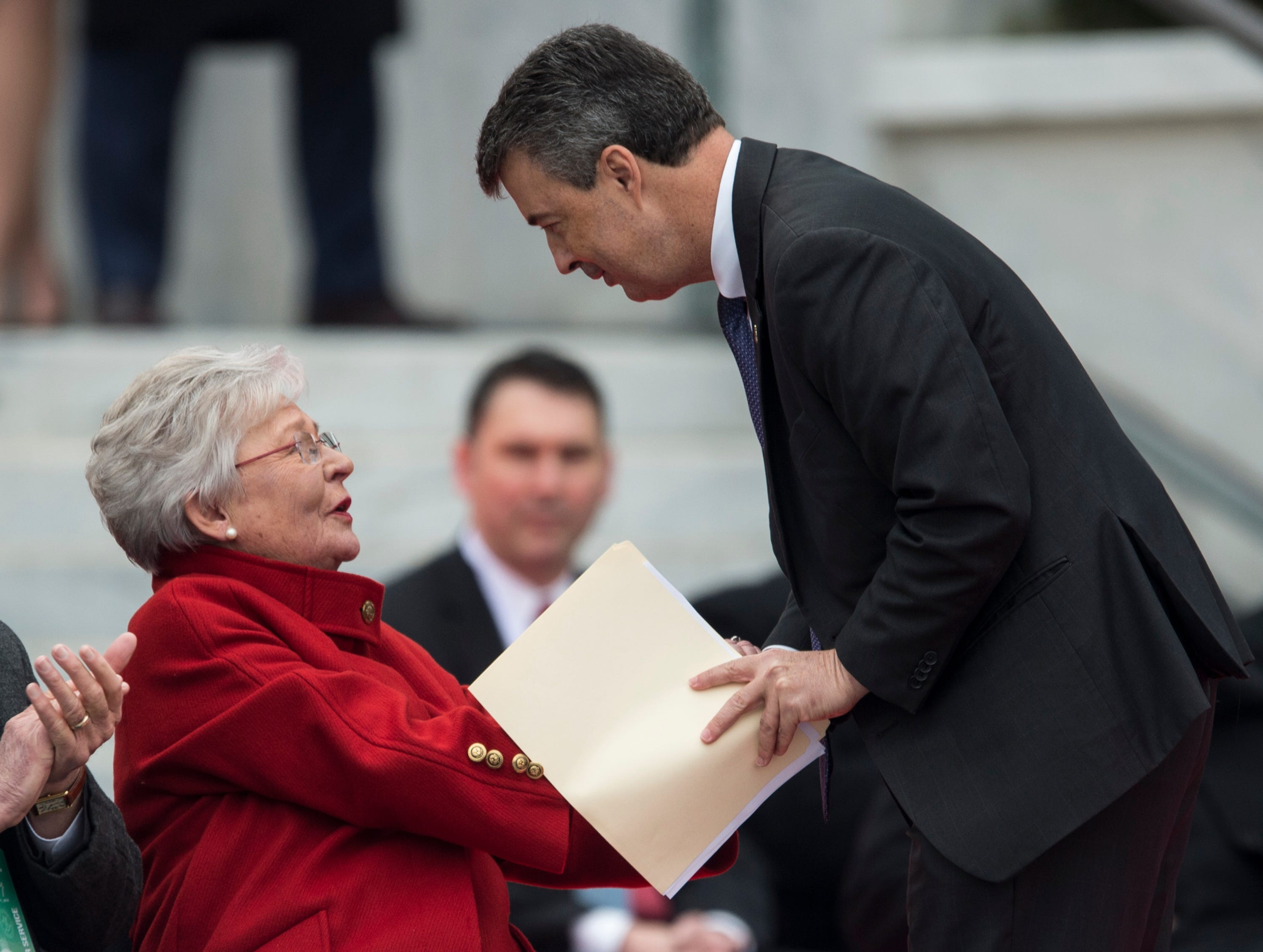 Alabama Gov. Kay Ivey congratulates Alabama Attorney General Steve Marshall after he is sworn in during Inauguration  Day on the steps of the Alabama State Capitol in Montgomery, Ala., on Monday, Jan. 14, 2019.