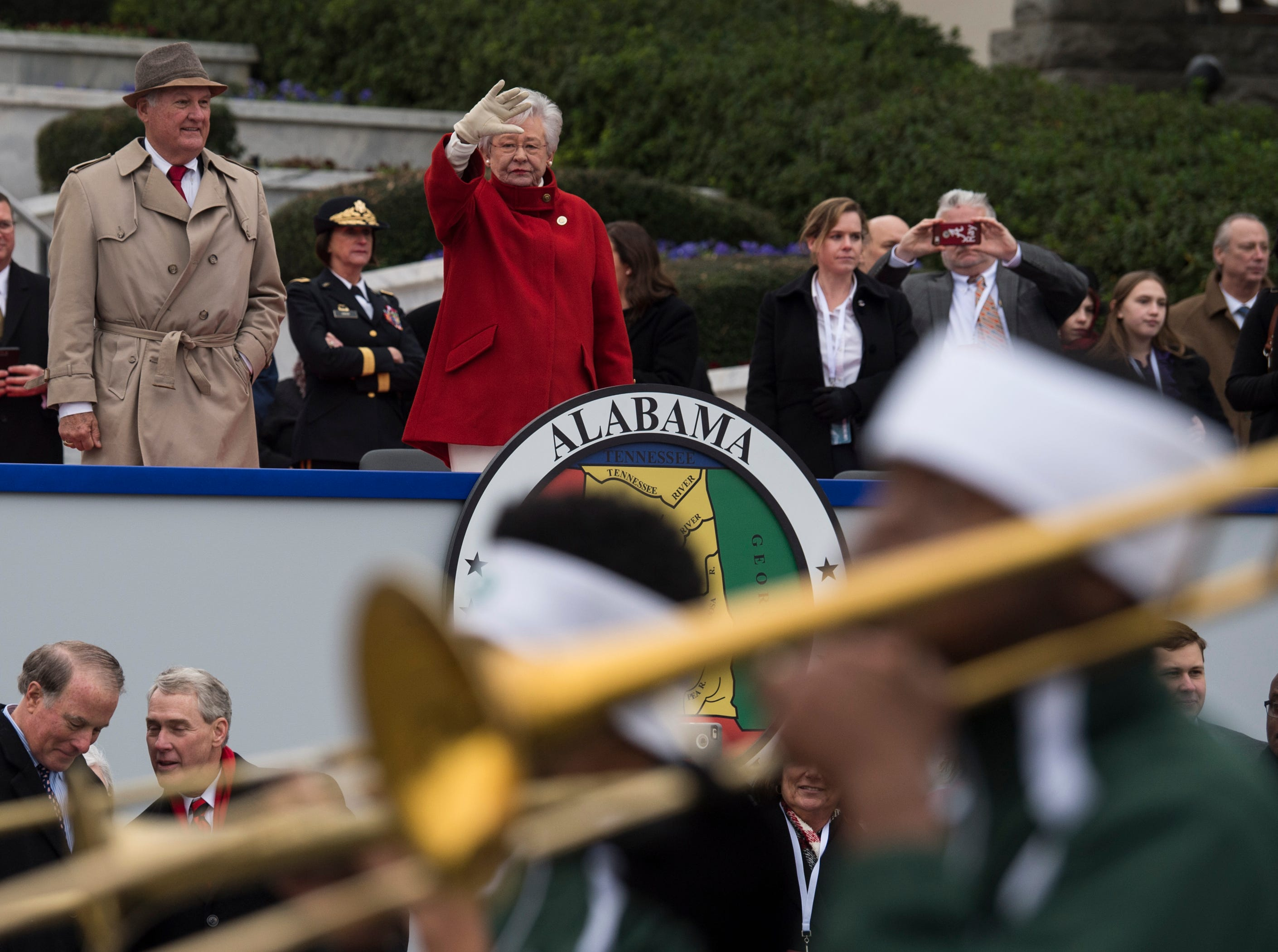 Alabama Gov. Kay Ivey waves to the Jefferson Davis High School marching band during the inauguration day parade in Montgomery, Ala., on Monday, Jan. 14, 2019.