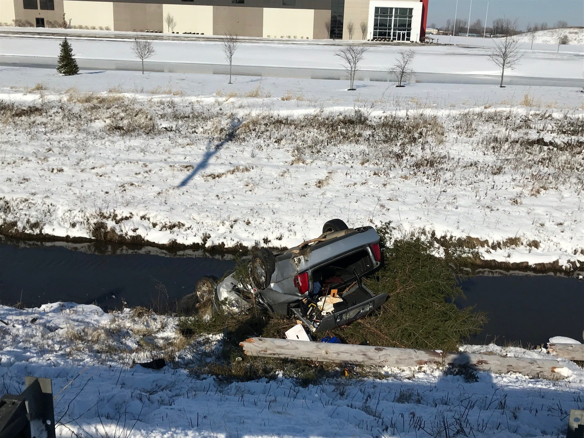 One person was injured Monday afternoon when her vehicle left Old. Ind. 67 west of Cowan Road, struck and broke a utility police, then flipped onto its roof in a drainage ditch.