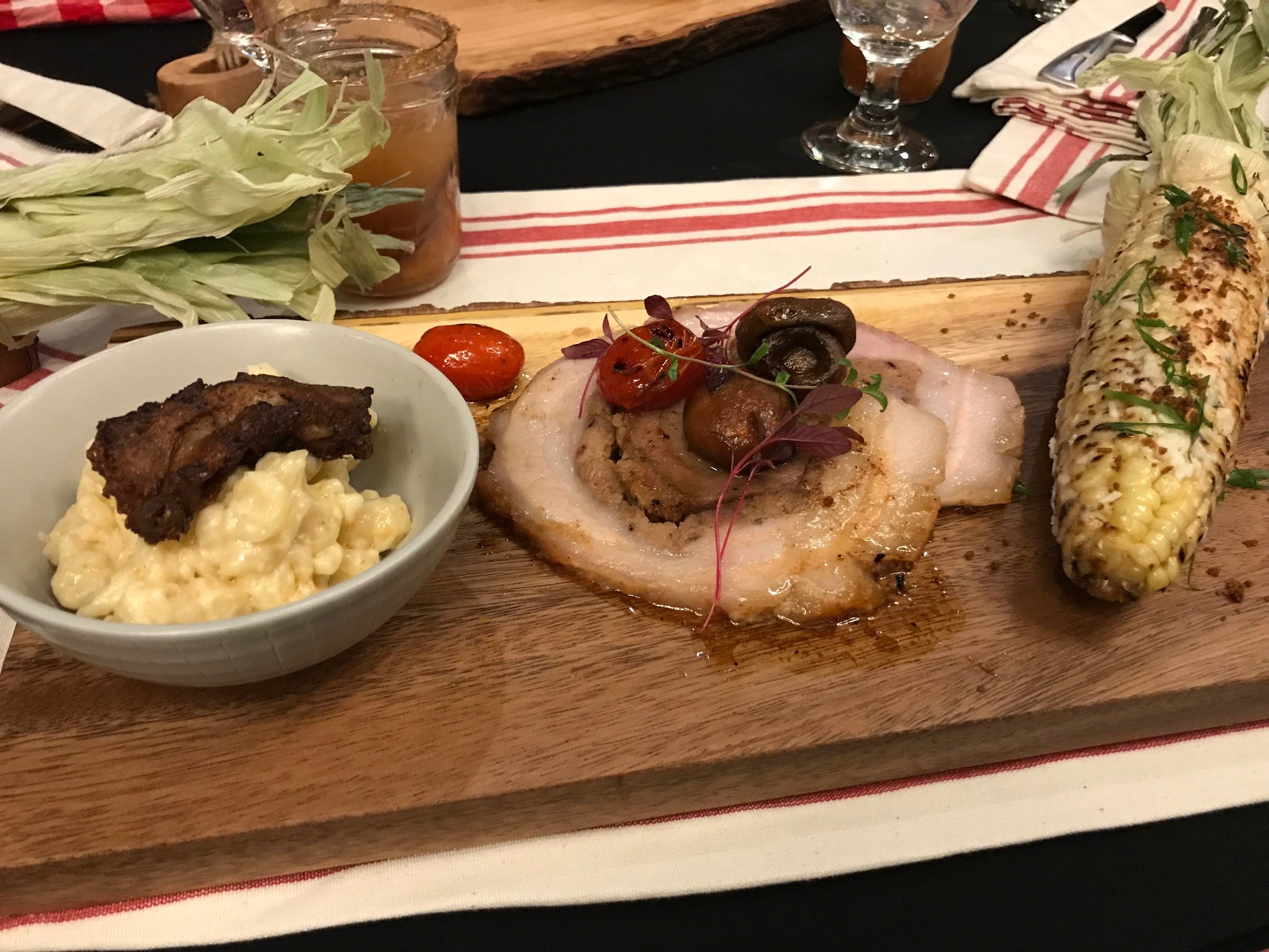 Chef Cory Coleman of The Harding House prepared a maple bacon glazed shoulder porchetta, head cheese pigtales & cheese and southern grilled corn at the 2019 Taste of Elegance.
