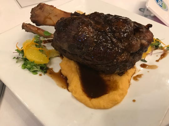 Braised pork shank with citrus rutabaga puree and candied orange zest prepared by Chris Bansbach of Five Senses Catering in Murfreesboro at the 2019 Taste of Elegance.