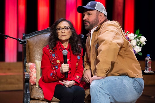 Loretta Lynn with Garth Brooks announces she will celebrate her 87th birthday in April with a star-studded concert at a press conference at the Grand Ole Opry Monday.