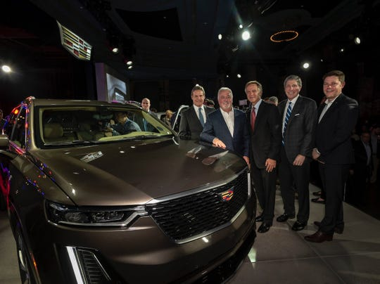 Gov.-elect Bill Lee and Gov. Bill Haslam pose next to the Cadillac XT6 Sunday  at the Detroit Auto Show. The SUV will be produced at the Spring Hill, Tenn., plant.