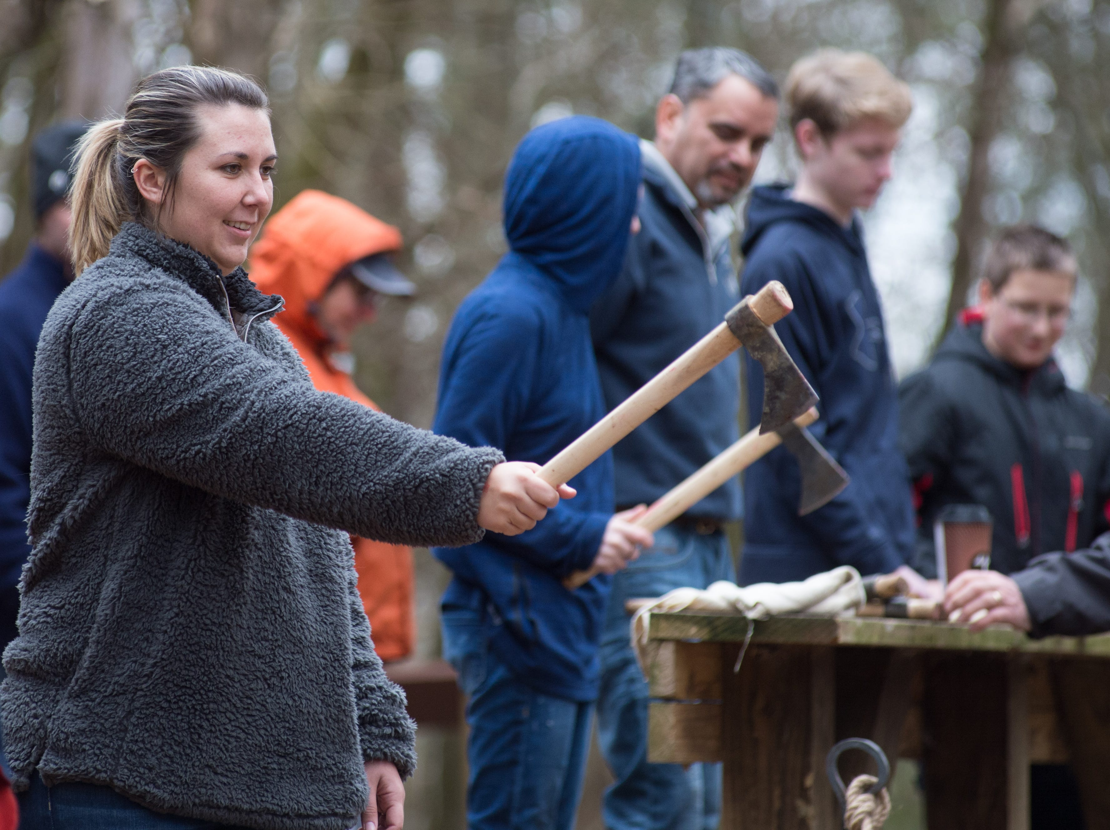 Lynsey Tolar has a good time during a Tomahawk Throwing for Beginners event hosted by Middle Tennessee History Coalition at Bledsoe Creek State Park on Saturday, Jan. 12.