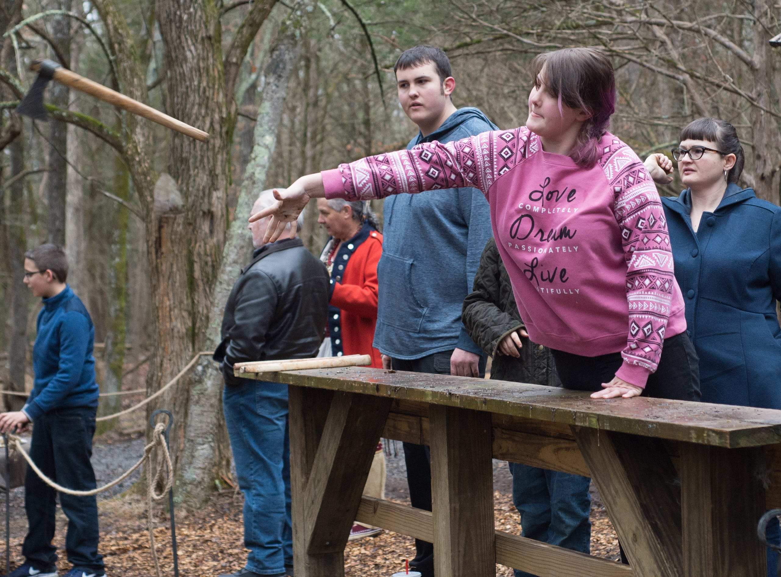 Esther Cooper gives it a try during a Tomahawk Throwing for Beginners event hosted by Middle Tennessee History Coalition at Bledsoe Creek State Park on Saturday, Jan. 12.