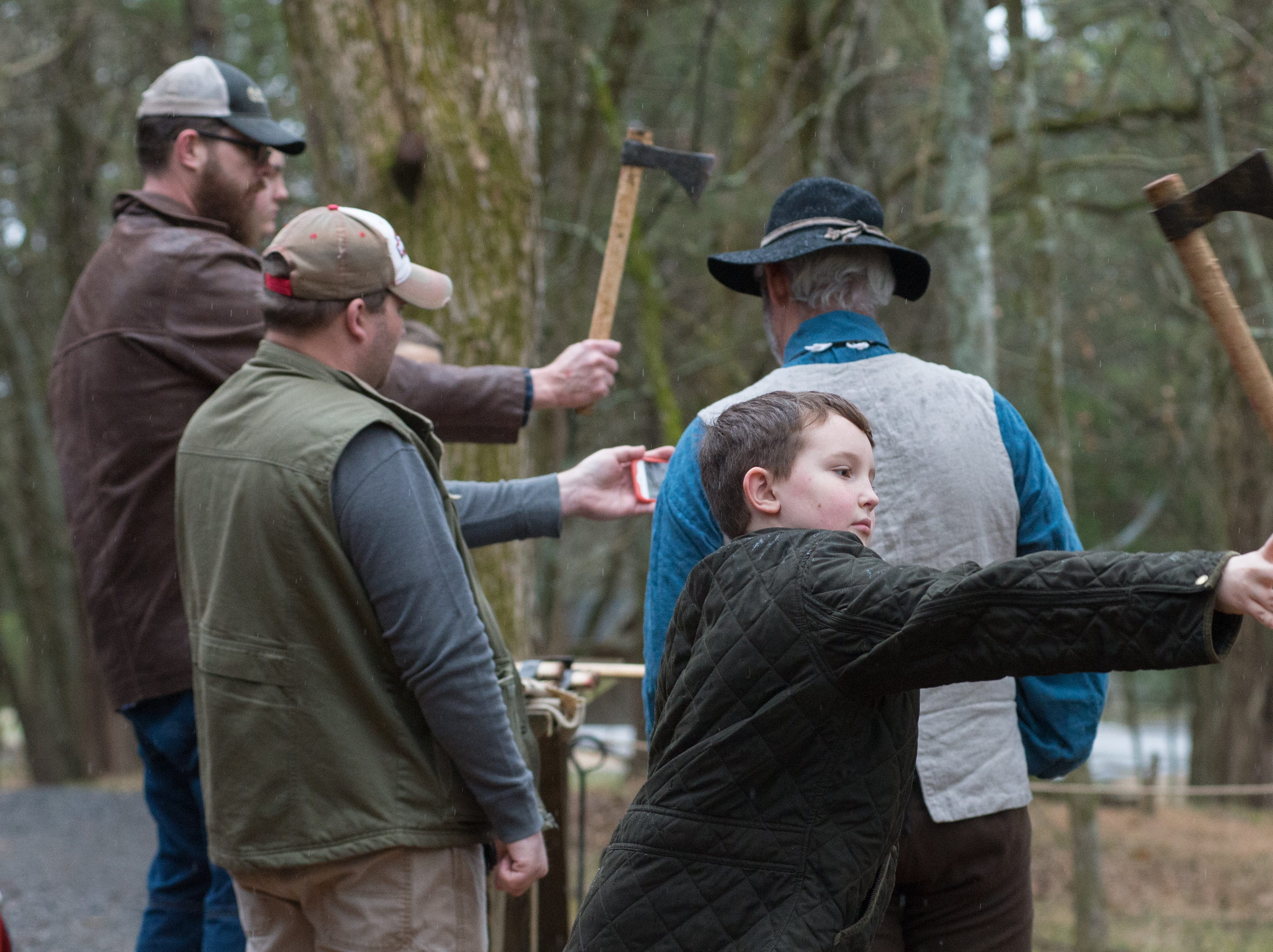 Enoch Cooper participates in a Tomahawk Throwing for Beginners event hosted by Middle Tennessee History Coalition at Bledsoe Creek State Park on Saturday, Jan. 12.