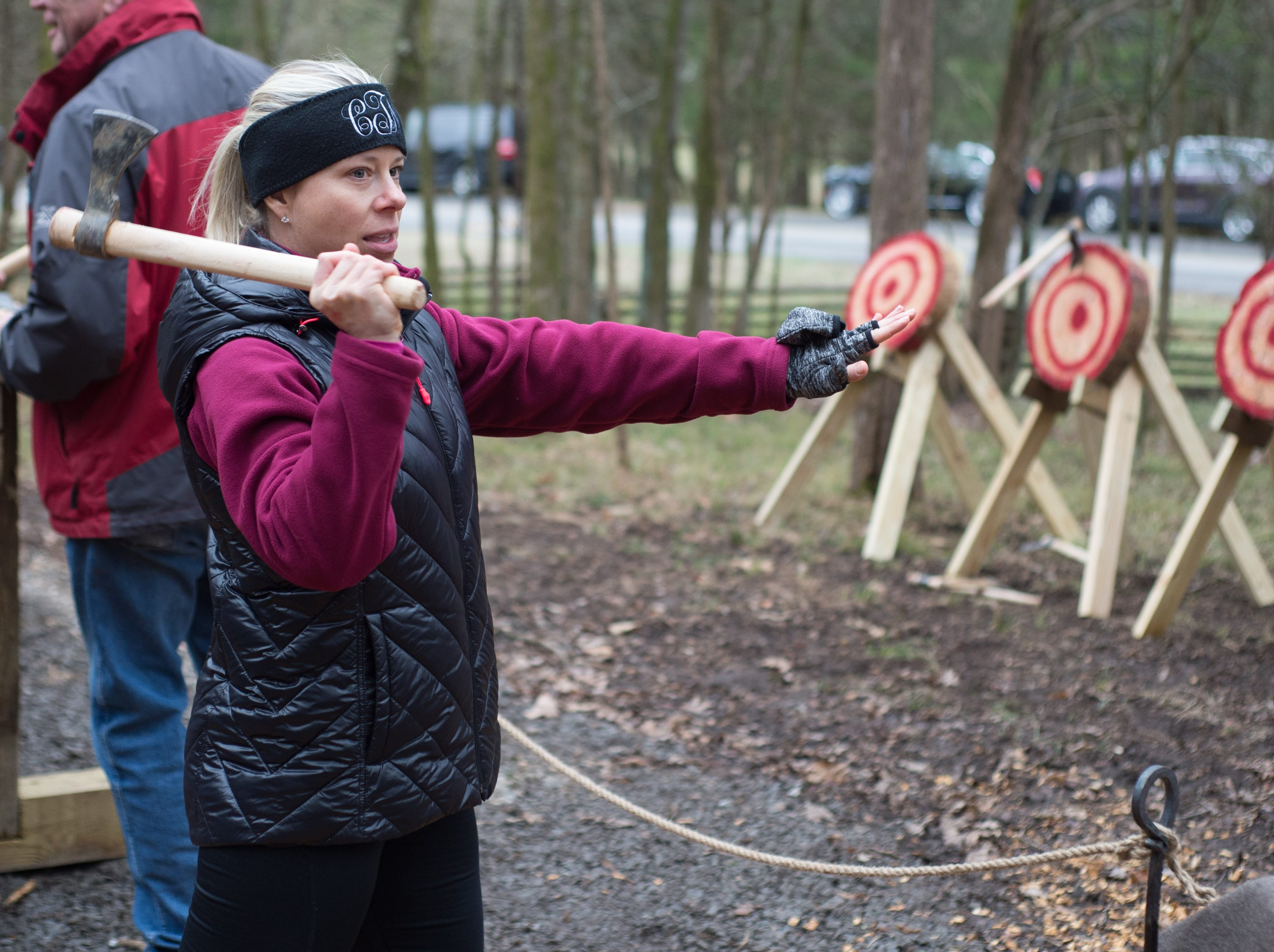 Candice Thurman learns good technique during a Tomahawk Throwing for Beginners event hosted by Middle Tennessee History Coalition at Bledsoe Creek State Park on Saturday, Jan. 12.