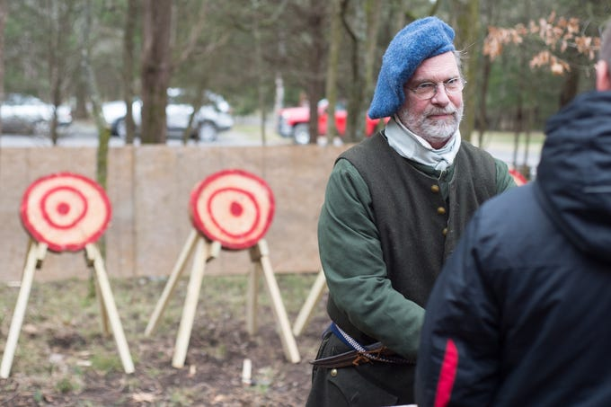 Elyon Davis helps with a Tomahawk Throwing for Beginners event hosted by Middle Tennessee History Coalition at Bledsoe Creek State Park on Saturday, Jan. 12.