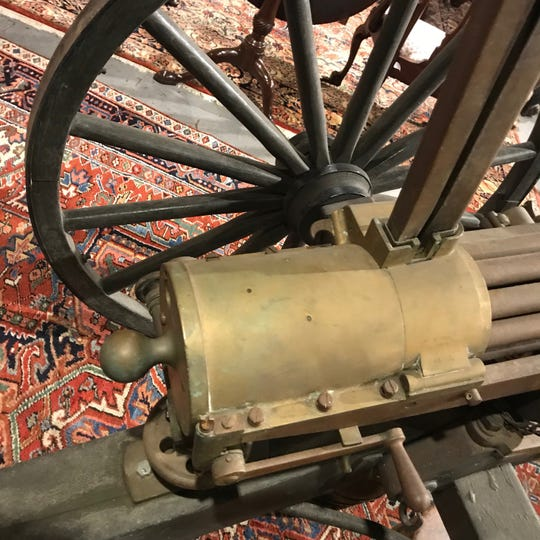 A look at the hand crank ,which sent the gun barrels spinning in this 1870s Gatling gun.