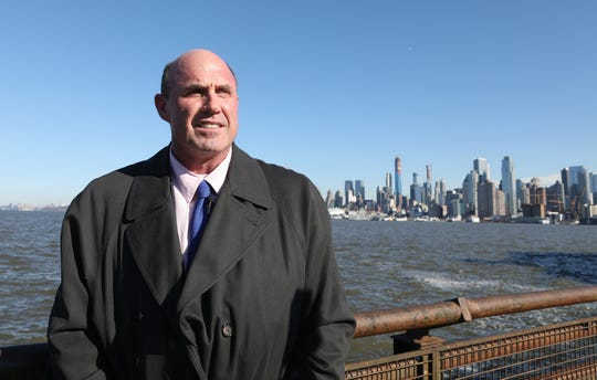 Dave Sanderson, of North Carolina, was one of 150 passengers on flight U.S. Airways Flight 1549 ten years ago, better known as the 'Miracle on the Hudson'. He is shown here, alongside the Hudson River in Weehawken, on the eve of the tenth anniversary of the flight. Sanderson said he could here his mothers voice clearly advising him as to what he should do once the plane landed.  His mother had died more than ten years before the incident and Sanderson is credited as helping other passengers off the plane. Monday, January 14, 2019