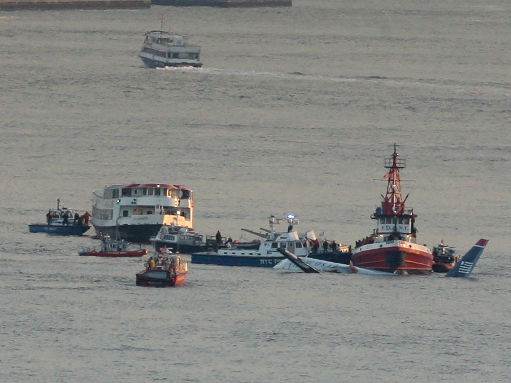 View of the US Airways plane surrounded by emergency crews on the Hudson River just south of Weehawkin.