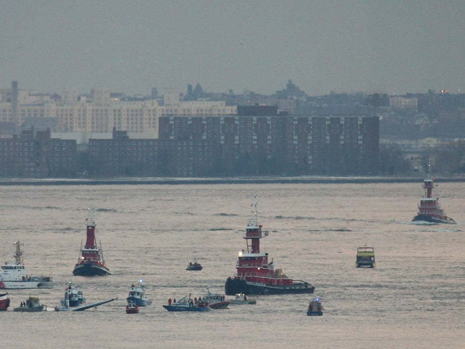 A view of the plan surrounded by emergency crews on the Hudson River.