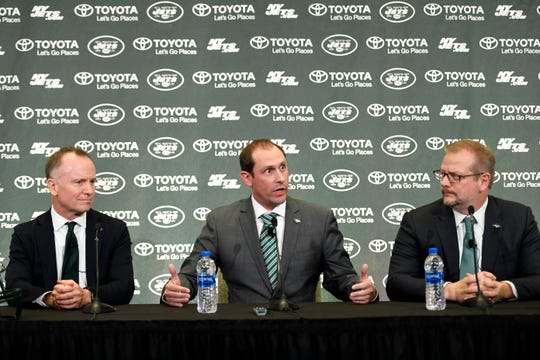 (from left) New York Jets CEO and Chairman Christopher Johnson, new head coach Adam Gase, and General Manager Mike Maccagnan answer questions from the media during a press conference on Monday, Jan. 14, 2019, in Florham Park.