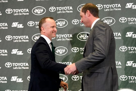 The New York Jets CEO and Chairman Christopher Johnson, left, shakes hands with new head coach Adam Gase during a press conference on Monday, Jan. 14, 2019, in Florham Park.