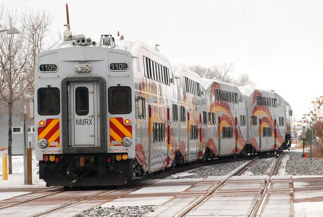A New Mexico Rail Runner commuter train departs from Santa Fe, N.M, Monday, Jan. 14, 2019. A report released Monday by the Legislative Finance Committee shows there were more than three-quarters of a million trips taken during the last fiscal year. That is 37 percent below the peak of 1.2 million during the 2010 fiscal year.