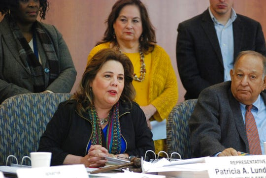 New Mexico lawmakers including Rep. Patria Lundstrom, left, D-Gallup, announces a proposal for an 11 percent increase in general fund spending for the coming fiscal year amid a surge in state government income on Monday, Jan. 14, 2019 in Santa Fe, N.M. Most of the new spending would go toward efforts to improve public education as the judiciary threatens to intervene to ensure adequate resources for struggling schools. Lundstrom is chairwoman of the legislature's lead budget writing committee.