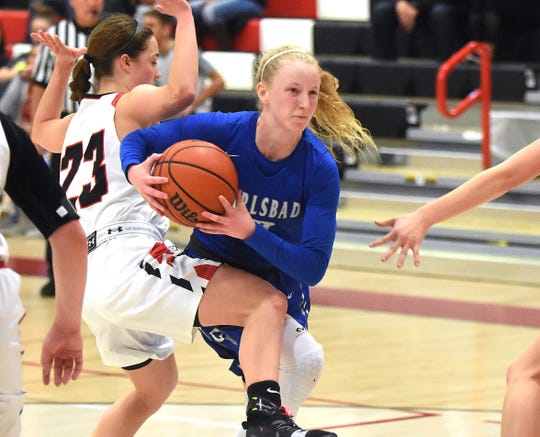 Carlsbad guard Carsyn Boswell muscles past Portales defender Mattison Blakey in the third quarter of Saturday's game at the Portales Shootout. Boswell had a game-high 23 points in the Cavegirls' 45-33 victory.